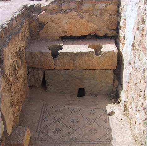 Roman latrines with wonderful mosaic on the floor at Bulla Regia. Bulla Regia is an archaeological site in northwestern Tunisia, a former Roman city near modern Jendouba.