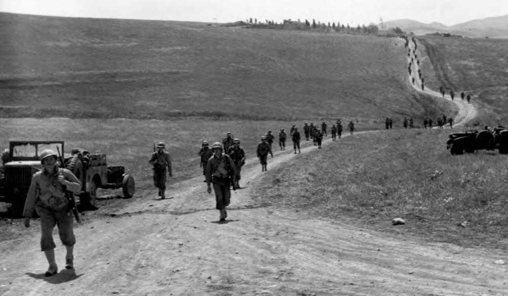 American infantry advancing toward German positions in Tunisia in early May 1943 (Official U.S. Army photo).