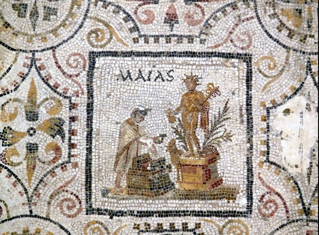 Roman personification of the month of May making a sacrifice to Mercury. The figure might be dressed like a soldier, with a helmet and red-bordered tunica manicata. Panel from the calendar mosaic found at a villa near