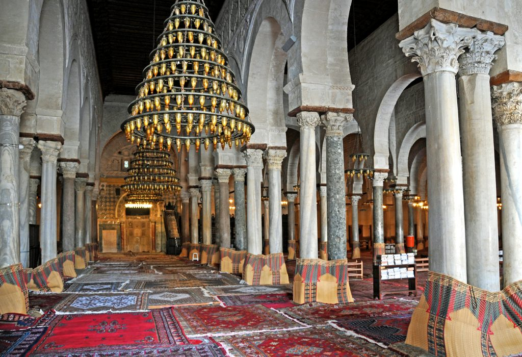 Interior view of the hypostyle prayer hall in the Mosque of Kairouan. Photo by Dennis Jarvis.