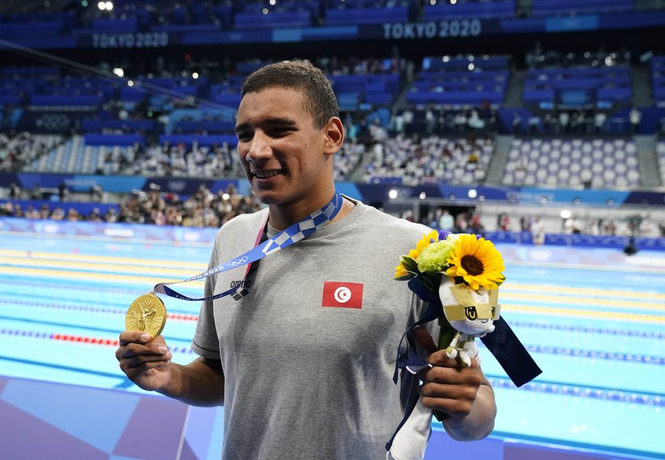 Jul 25, 2021; Tokyo, Japan; Ahmed Hafnaoui from Tunisia celebrates with his gold medal during the medals ceremony for the men's 400m freestyle during the Tokyo 2020 Olympic Summer Games at Tokyo Aquatics Centre. Credit: Rob Schumacher-USA TODAY Network.