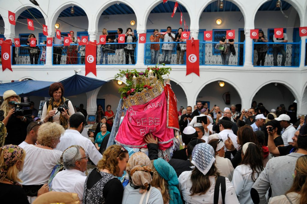 The procession with the Menorah. The end of the Lag ba-Omer Jewish holiday on the Djerba island.