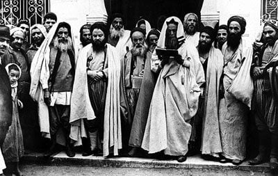 Rabbis at the entrance of El Ghriba synagogue, Tunisia, 1940's. Beit Hatfutsot, the Oster Visual Documentation Center. Courtesy of Charles Hadad, France.